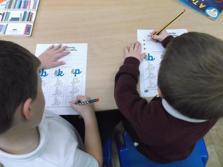 We practise our cursive handwriting.