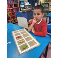 Counting out objects using 1:1 correspondence on the tens frame