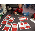 Matching the numbers on the postcards to the correct door numbers