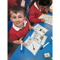 Writing CVC words. We are very good at phonics!
