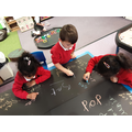 We have been practising writing CVC words with chalk
