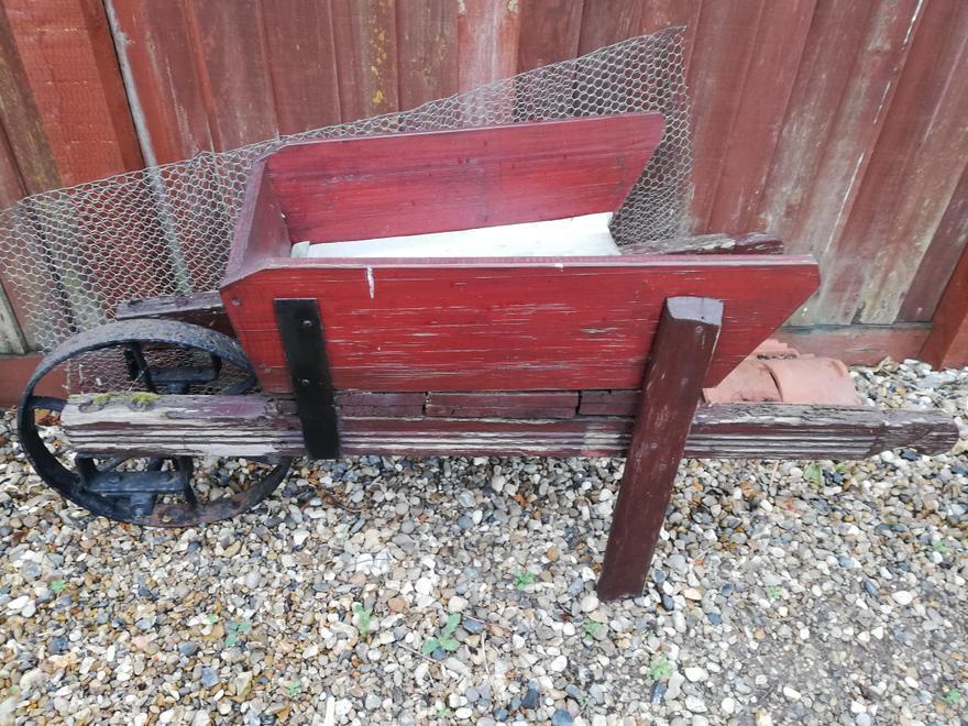 A wheelbarrow in need of love