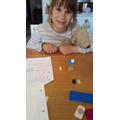 Georgia's teddy helping with maths