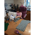 Georgia helping mum to make Christmas stockings for Project Linus to go to Children's war