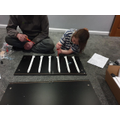 Rachel builds furniture with her dad