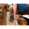 Tom making curry