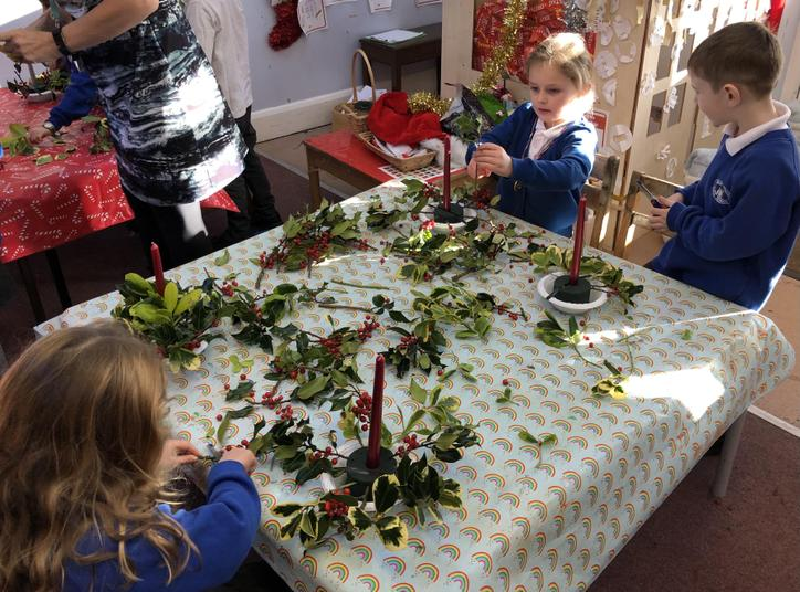 Fun making holly table decorations!