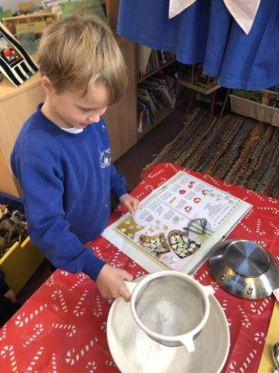 A member of Tawny class sifting the icing sugar.