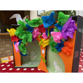 Heera's- an opened box decorated with bright tissue paper and hand drawn animals!