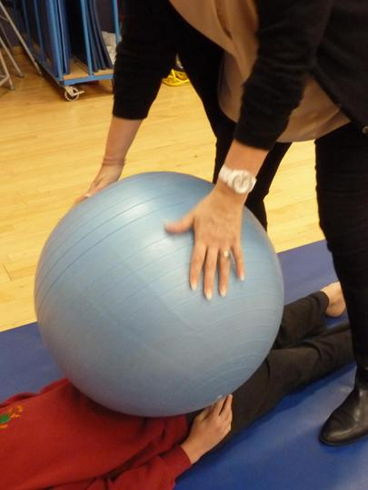 Calming - being 'squashed' with gym ball.