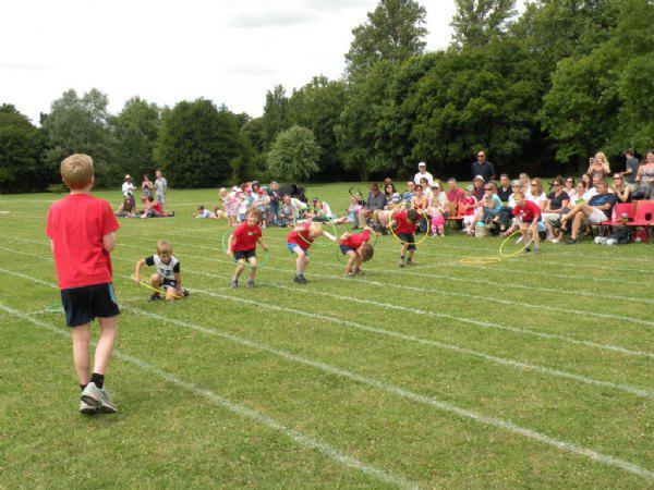 KS1 children raced through hoops......