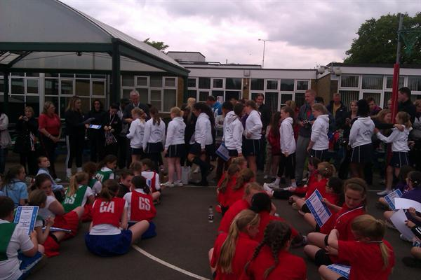 Collecting their medals
