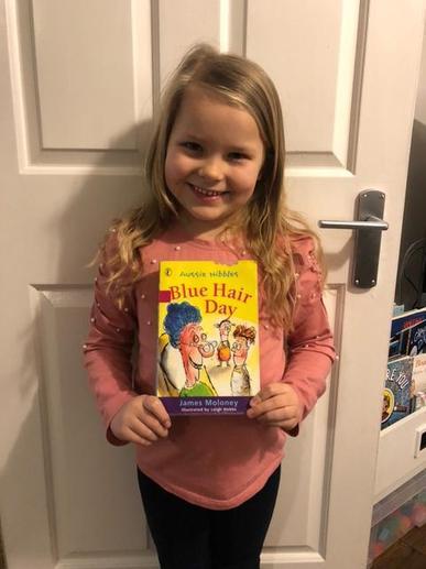 Felicity 'gobbling up' books!