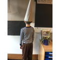 Wearing the dunces hat!