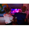 Children enjoying time in the dark room