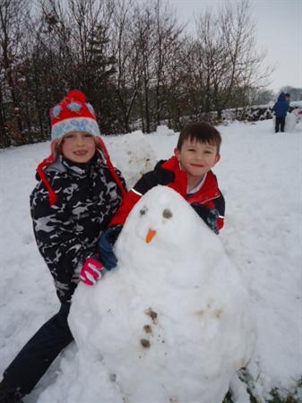 Children enjoy making a snowman