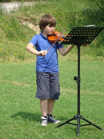 Playing violin at our concert