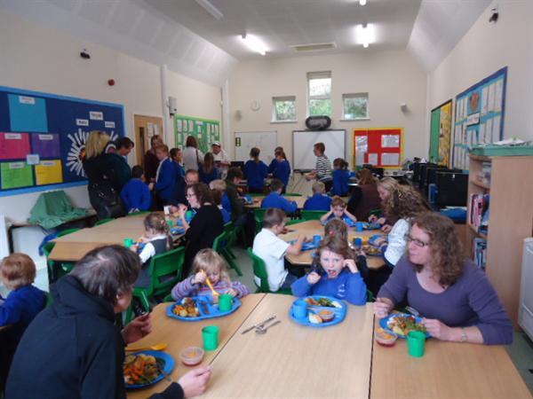 Parents enjoy a delicious school dinner