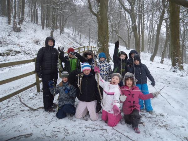 Having fun in the snowy woodland