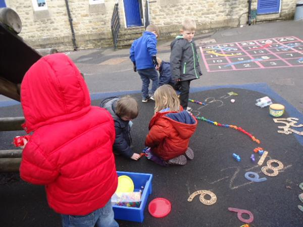 Reception children learning their numbers