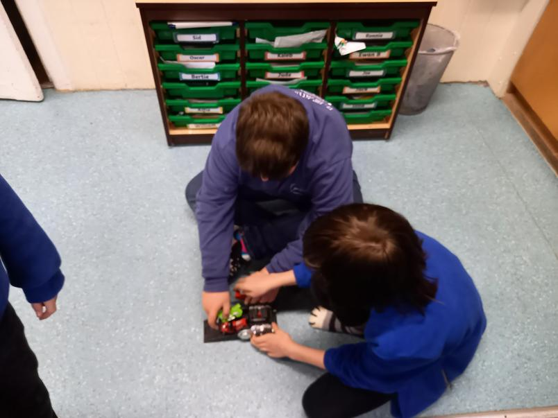 Investigating working parts of toys.