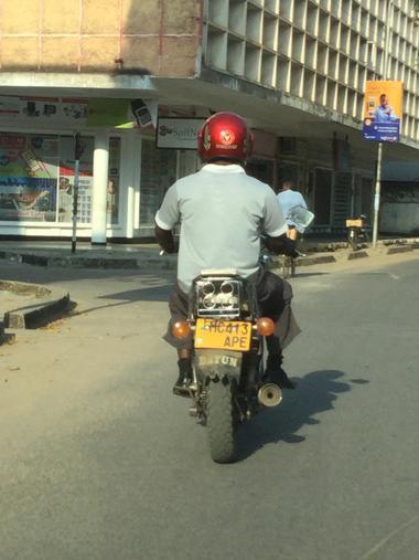 David on his motorbike on his way to school