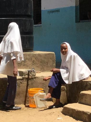 Collecting water and washing their faces