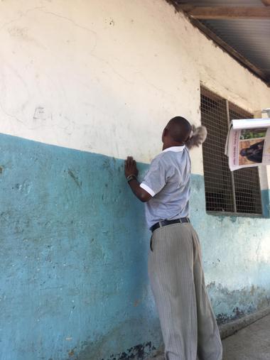 Mr Mzimbo preparing the wall to paint