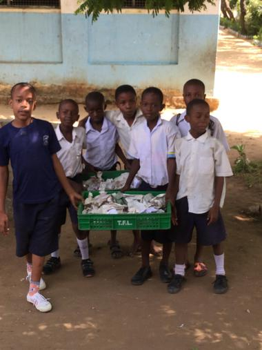 Children collecting rubbish from the classes