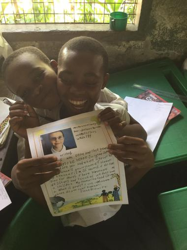 Two boys loving a letter from Dean