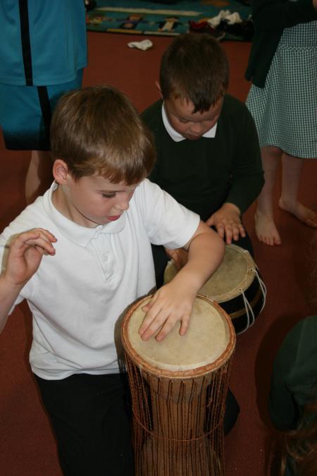 Enjoying playing African drums