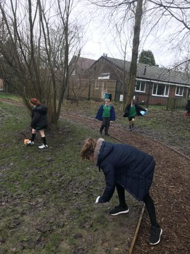 Tidying the school grounds.