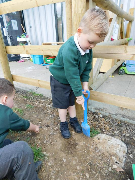 Seeing if there is treasure in the garden