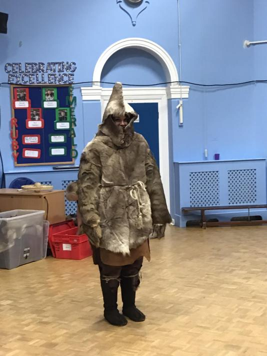 Mrs Baker had to dress up as a Stone Age hunter!