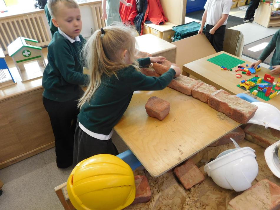 Evie-Rose and Aiden building a fantastic wall...