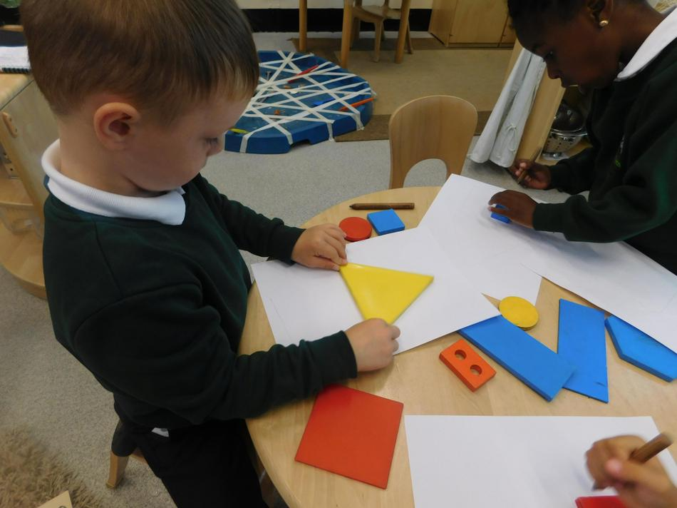 Tommy drew a house with his 2D shapes.