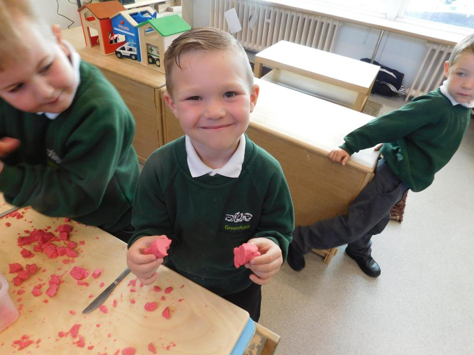 We created playdough shapes and cut them in half.