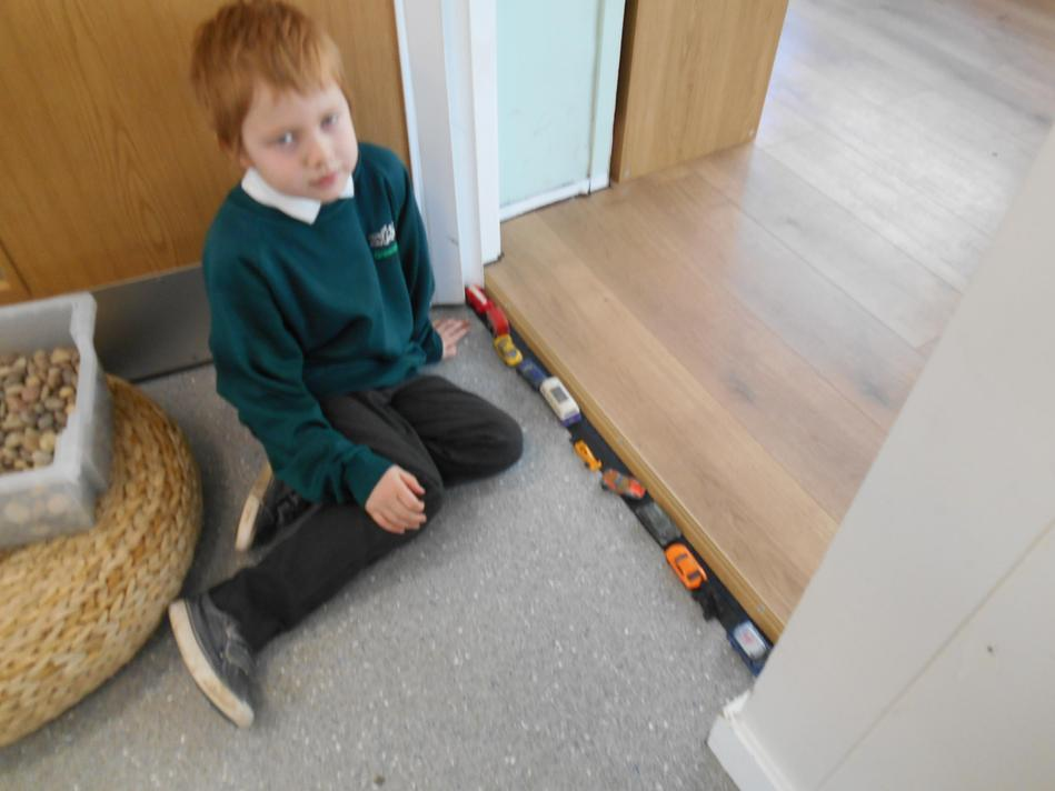 Theo created his own standard unit using toy cars.