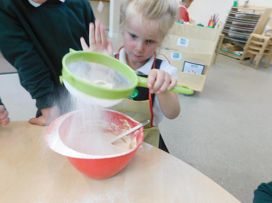 Maisie-Jane helped to bake some fairy cakes.