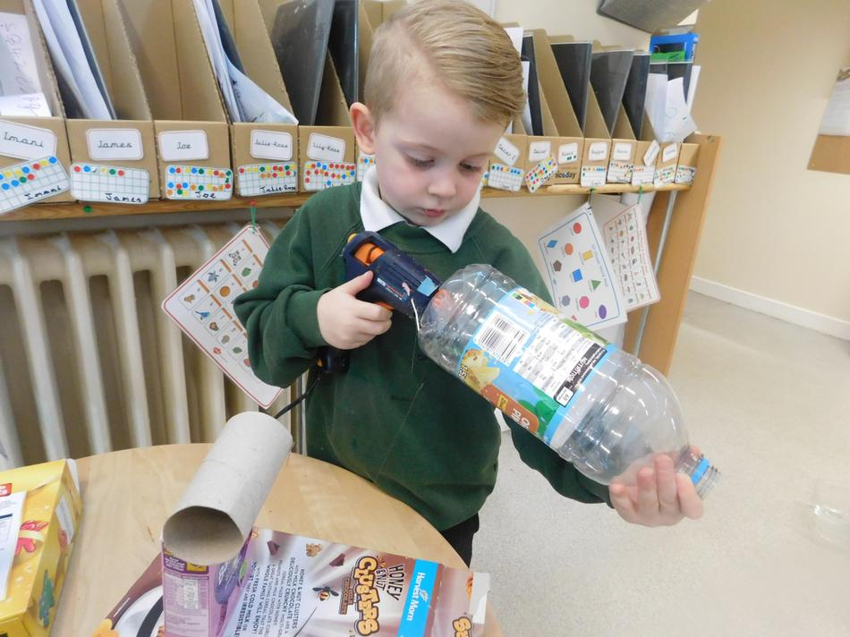 Thomas using the glue gun carefully.