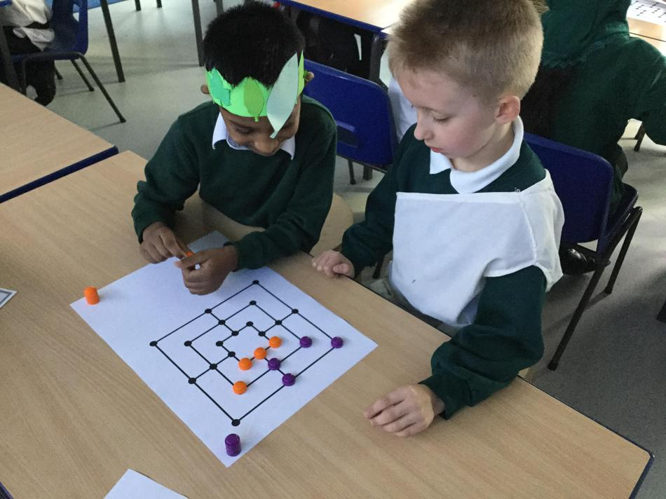 Playing a Roman board game, 'Nine Men's Morris'