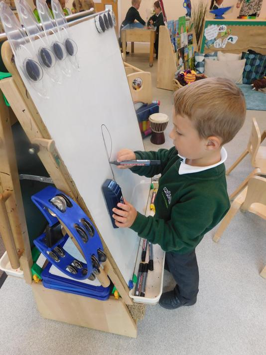 Maksim practicing his letters.