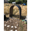 An old reading arch was painted up and placed at the far end of the path.