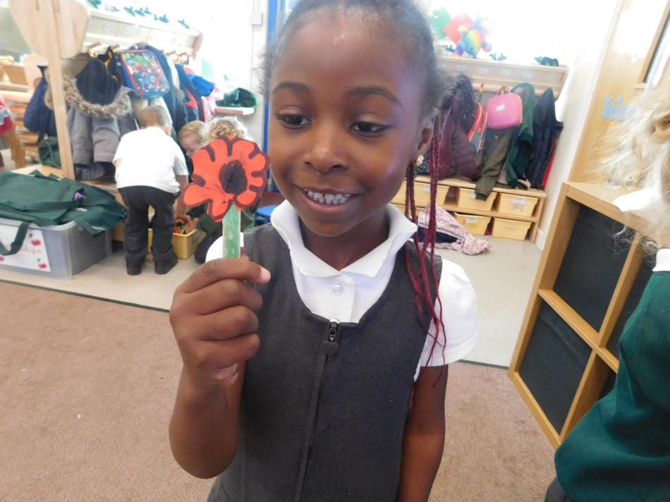 Imani made a poppy independently.
