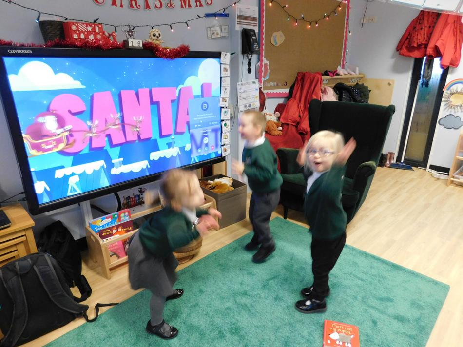 The children love dancing to Christmas music.