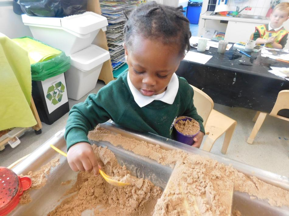 Making a cup of tea in the sand tray.