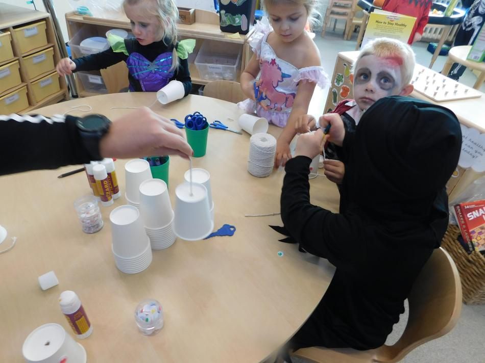 Maisie-Jane and Zofia making ghosts.