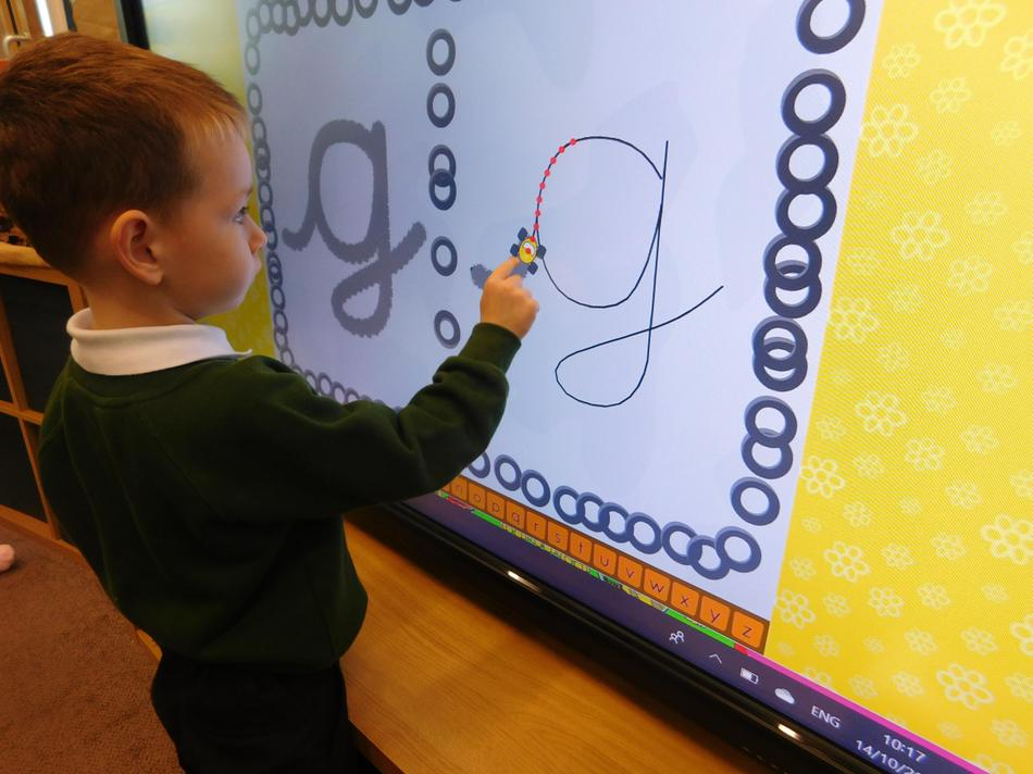 Oscar practising his letter formation.