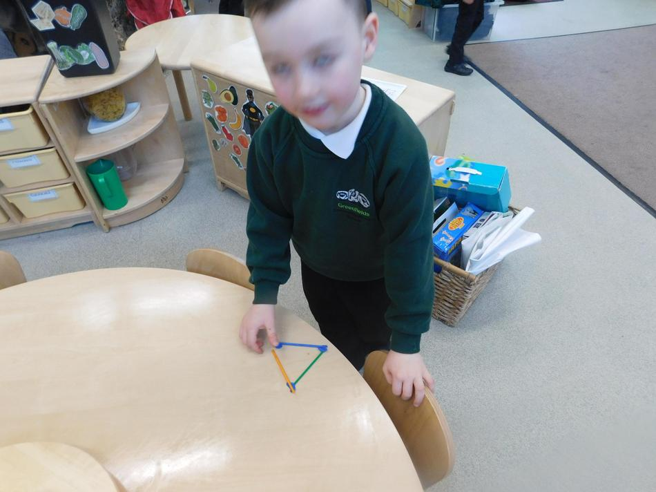 George working on 2D shapes.