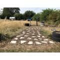 Over time, the chippings will level out and the path will settle.